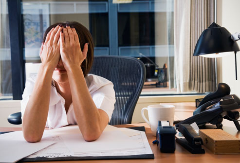 getty_rm_photo_of_tired_woman_at_office[fusion_builder_container hundred_percent=