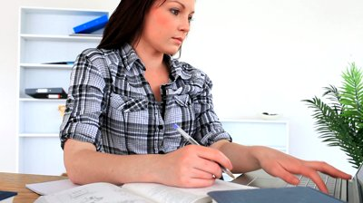 stock-footage-female-student-working-while-surfing-on-her-laptop-in-the-living-room[fusion_builder_container hundred_percent=