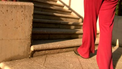 stock-footage-woman-walking-up-stairs-for-health[fusion_builder_container hundred_percent=